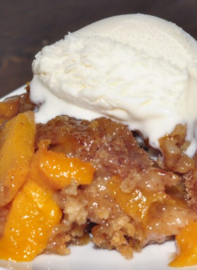 Crock Pot or Slow Cooker Peach Cobbler dessert recipe is best served warm and topped with vanilla ice cream. It's an easy dessert to throw in the crock pot and just let it cook. Everyone loves this!