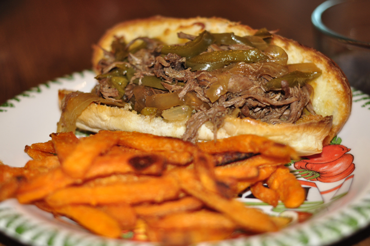 Easy and delicious crock pot or slow cooker French Dip Sandwiches recipe with peppers, onions, and au jus sauce served on french rolls.