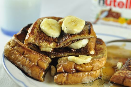 This Banana and Nutella Stuffed French Toast recipe is a quick and easy sweet breakfast indulgence that you will make again and again!