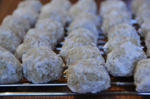 """Fast and easy Walnut Snowball Cookies, or """"Mexican Wedding Cookies"""", are a delicious nutty holiday dessert recipe for a crowd! These are the perfect Christmas cookie exchange idea!"""