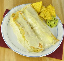 Honey Lime Chicken Enchiladas for Cinco de Mayo with a side of chips and guacamole