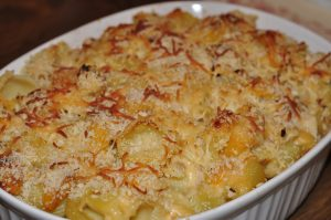 This is a creamy baked autumn mac and cheese recipe made with butternut squash, brussels sprouts, and chicken. This is a great fall comfort food recipe!