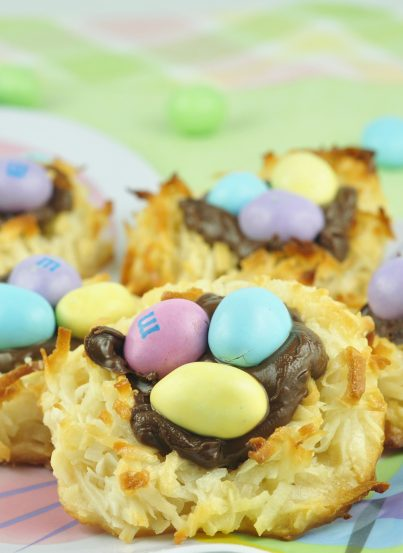 This is a quick and easy Easter dessert recipe for coconut macaroons filled with Nutella and topped with peanut M&M's to look like a bird's nest and eggs.