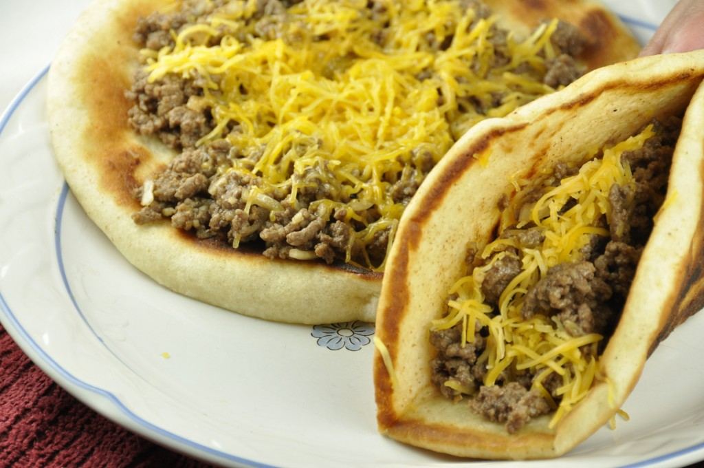 Cheeseburger Flatbread Melts recipe is an easy variation of tacos and sloppy joes combined into one. These are very kid-friendly!