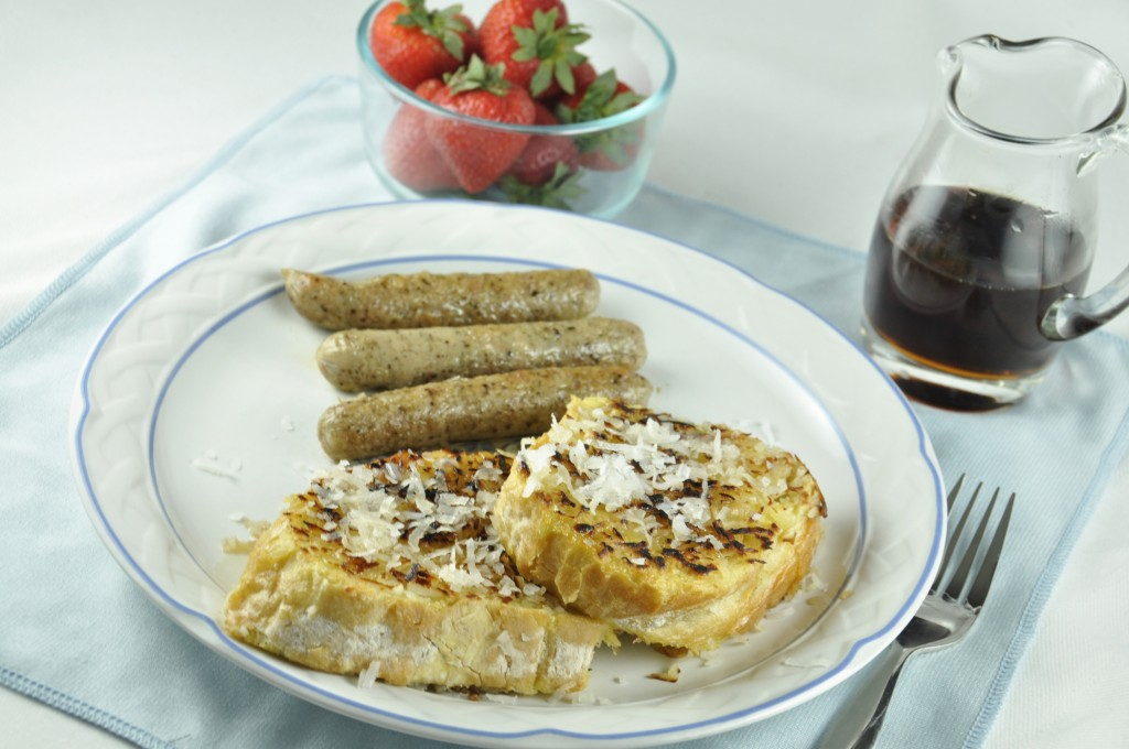 Coconut Crusted French Toast with strawberries and chicken breakfast sausage
