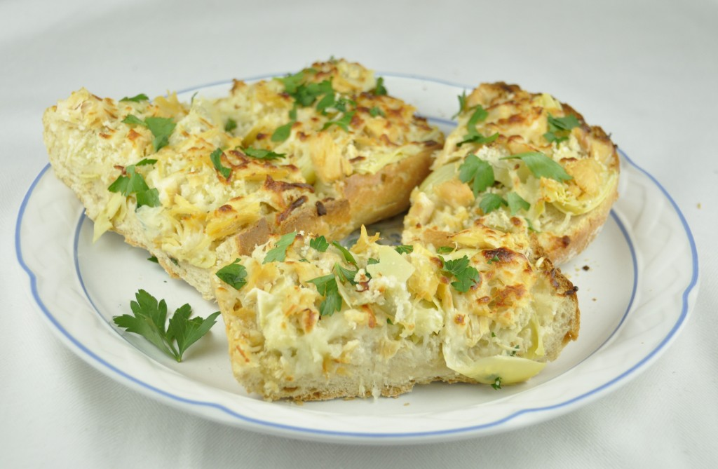 Cheesy Artichoke French Bread Pizza with Panko bread crumbs. Perfect party appetizer!