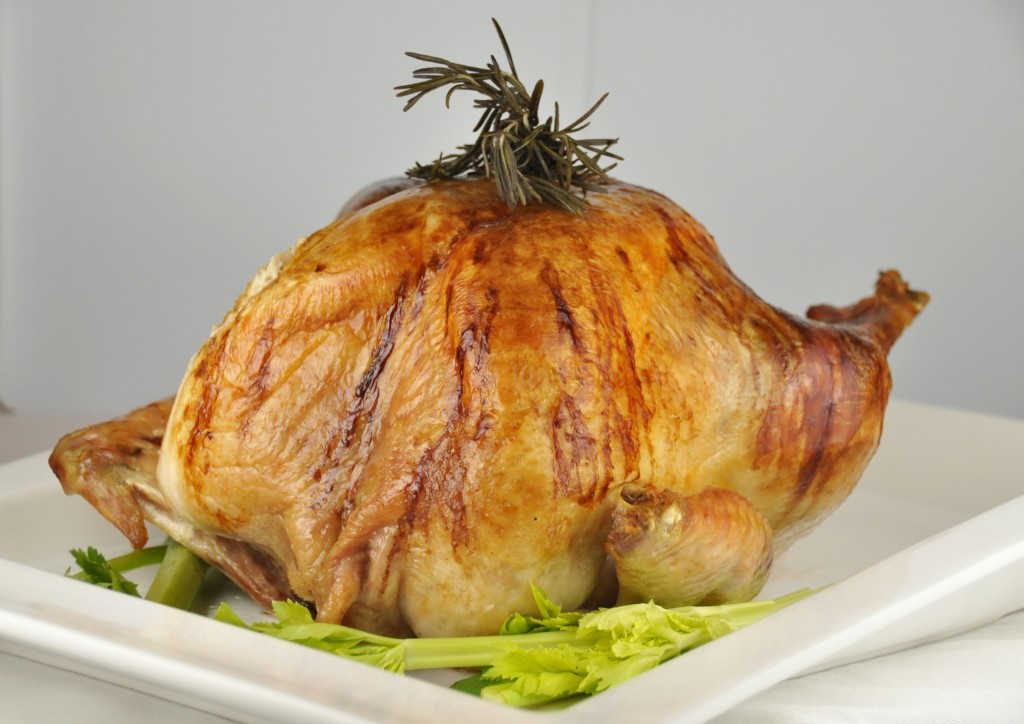 Thanksgiving Turkey stuffed with rosemary, sage, apple, onion and cinnamon stick.  Great for any holiday!