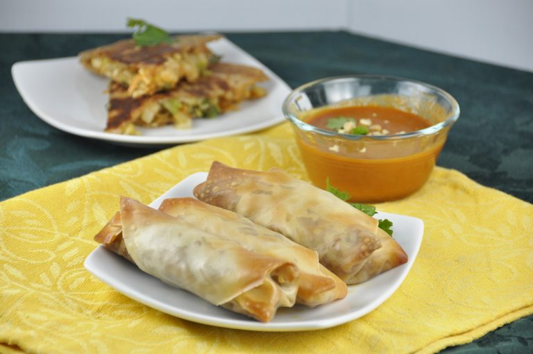 Crispy Baked Pork Spring Rolls with a Thai flair. Perfect dinner recipe or appetizer recipe for your Super Bowl party!