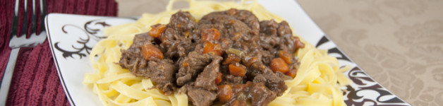 Old Fashioned Beef Stew Recipe served over buttered egg noodles