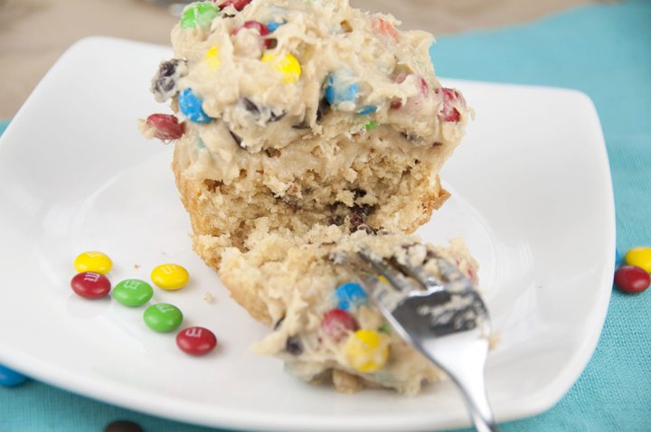 Monster Cookie Dough Cupcakes are rich peanut butter cupcakes topped with a sweet and loaded cookie dough frosting packed full with peanut butter, chocolate chips and M&M candy! This is the best cupcake recipe ever!