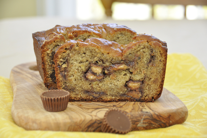 Reese's Pieces Peanut Butter banana bread is classic banana bread with a makeover. This bread has a generous helping of peanut butter and Reese's peanut butter cups. This easy loaf recipe is a delicious breakfast treat or snack!