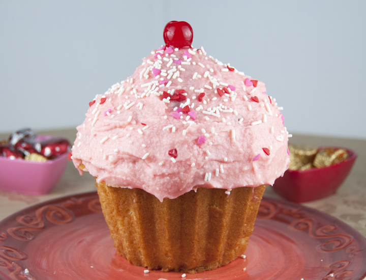 Fun Giant Cupcake Recipe made in the Wilton Pan. This is a show-stopper dessert for your Valentine!