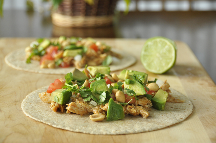 Slow Cooker Peanut Chicken Tacos recipe with avocado and peanuts made right in the crock pot for an amazing and easy Thai dish for summer!