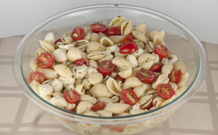 Caprese Pasta Salad that is great for any BBQ or party where you need to feed a crowd.  Easy!