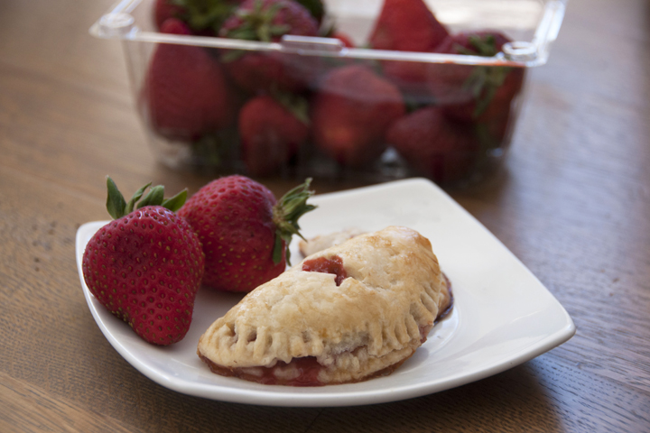 These easy-to-assemble hand-held strawberry hand pies make a satisfying treat any time of the day and are perfect for spring and summer dessert!