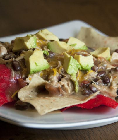 Crock Pot Creamy Chicken Nacho Sauce recipe to serve over chips. Great for game day!
