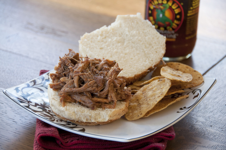 Using root beer to tenderize slow cooked pork tenderloin makes a delicious preparation method of Crock Pot pulled pork.  Root beer gives these slow cooked pork sandwiches rich color and slight sweetness.