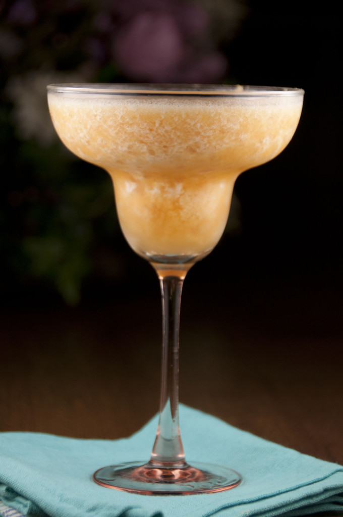This delicious frozen fresh peach daiquiri tastes so much better when made with fresh fruit. It is so good and so easy to make!