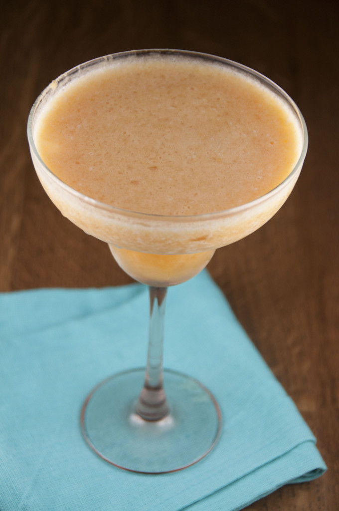 This delicious frozen peach daiquiri drink recipe tastes so much better when made with fresh fruit.  It is so good and so easy to make!