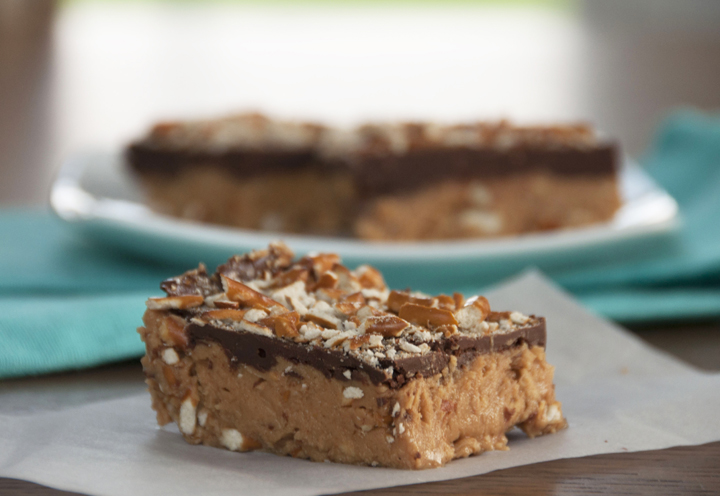 No-Bake Buckeye Pretzel Bars recipe is every peanut butter and chocolate lover's dream! This sweet and salty treat doesn't even require turning on your oven!