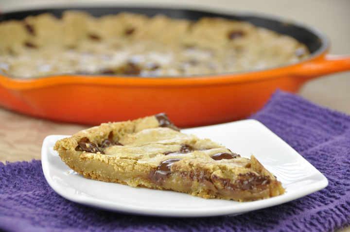 Dark Chocolate Chip Skillet Cookie Recipe. A giant chocolate chip cookie that is perfect to serve to company or dinner guests.