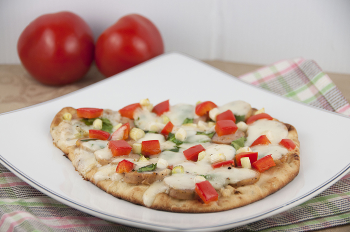 Naan Flatbread Pizza Recipe with fresh mozzarella, red pepper, and chicken sausage.