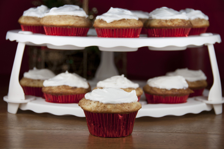 Recipe for moist vanilla cupcakes with a cinnamon sugary swirl, topped with a sweet buttery icing and rich cream cheese frosting.