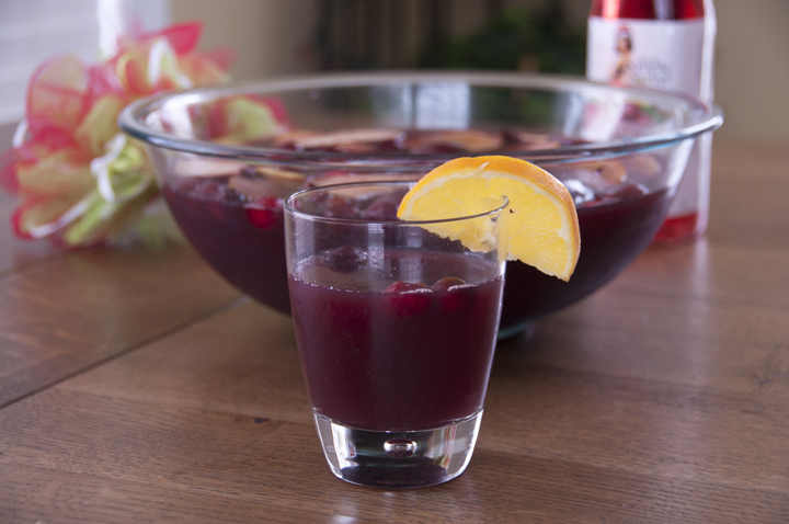 Cranberry Pomegranate Holiday Winter Sangria Recipe made with lemon, orange, and apple. Great for a party!