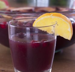 Cranberry Pomegranate sangria with orange, apples, and lemons makes a festive drink recipe to toast the winter holidays or Christmas party!