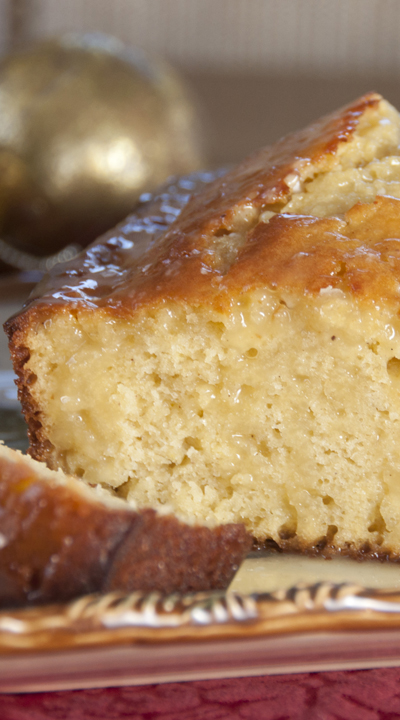 This Orange-Glazed eggnog bread recipe is a moist bread with a sweet orange eggnog glaze is a delicious dessert served with coffee or for Christmas breakfast!
