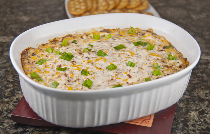Creamy Bacon and Cheese Dip loaded with bacon is the perfect, cheesy appetizer recipe for any party, game day or an easy super bowl party appetizer!