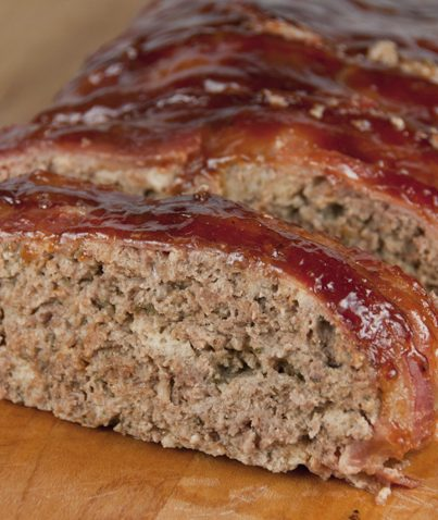 The best meatloaf recipe where the meatloaf is wrapped in bacon and brushed with barbeque sauce