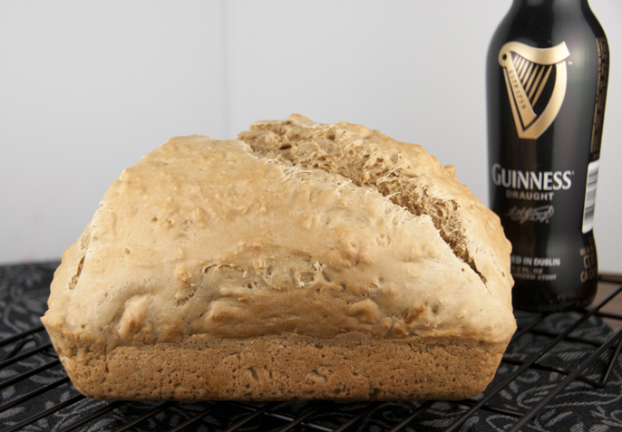 I love a great Irish Guinness beer bread recipe, especially for St. Patrick's Day. This Guinness version comes together super fast and couldn't be easier to make. Five minutes of work will reward you with a heavenly aroma throughout your house and a warm, crusty loaf in under an hour.