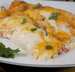 The best Cheesy Sour Cream Chicken Enchiladas Recipe that are great for Mexican food night!