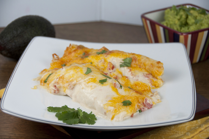 Cheesy Sour Cream Chicken Enchiladas Recipe.  Great for Mexican food night!