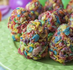 Easy Fruity Pebble Easter egg dessert treats are made with three simple ingredients: kids' cereal, marshmallows and butter. Shape them into Easter eggs to make a fun, easy, no-bake treat for the holiday!