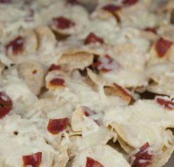 Pepperoni pizza nachos make a great cheesy snack or appetizer for any party.