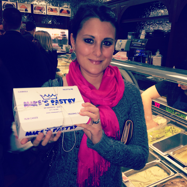 Me holding my box of pastries at Mike's Pastry in Boston