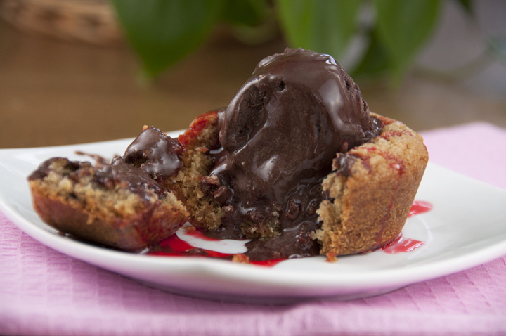 Giant Chocolate Chip Cookie Cups recipe a la mode topped with dark chocolate ice cream and finished up with a drizzle of strawberry syrup.  Great for Valentine's day.