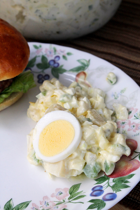 Tender red potatoes, hard-boiled eggs, and bright green bell pepper get tossed together to create this delicious Potato Salad recipe that is perfect for Summer picnics or Memorial Day!!