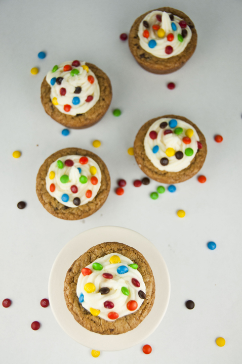 Giant Chocolate Chip Cookie Cups recipe with Almond Buttercream Icing topped with mini M&M's for a fun splash of color make for the perfect dessert for any occasion