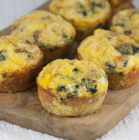 A recipe for Scrambled Egg Breakfast Muffins with sausage and green peppers or spinach that are pretty, hearty and fun to serve for breakfast or brunch.