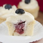 Homemade recipe for Strawberry-filled Patriotic Red White and Blue pound cake cupcakes with whipped cream cheese frosting.