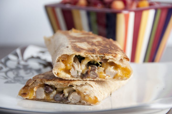 Crispy Southwest Chicken Wraps couldn't be easier to put together and are absolutely delicious with peppers, black beans and cheddar cheese.  Great lunch or dinner recipe.