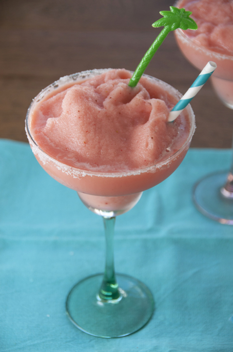 Frozen strawberry daiquiri cocktail recipe made with frozen fruit bars. Kid-friendly version included.