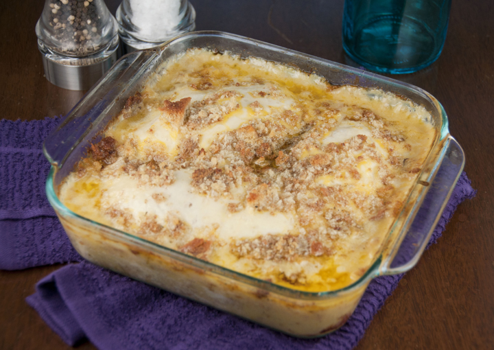 Chicken recipe in white wine cream soup is coated with the smooth, slightly sweet tang of melted Swiss cheese and topped with buttered stuffing.
