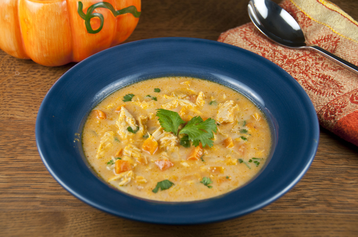 This easy pumpkin soup is made with chicken, pumpkin puree, chicken stock, and fresh vegetables Cream and cheese are stirred in at the end for added richness. The perfect fall soup!