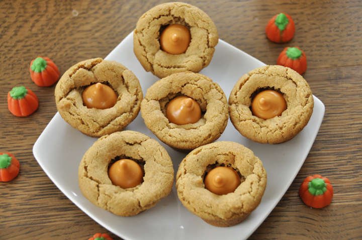 These peanut butter cookie cups are super fun with pumpkin spice Hershey's Kisses added to them. Kids of all ages will love this fall dessert.