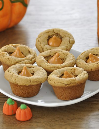 These peanut butter cookie cups are super fun with pumpkin spice Hershey's Kisses added to them. Kids of all ages will love this fall treat.