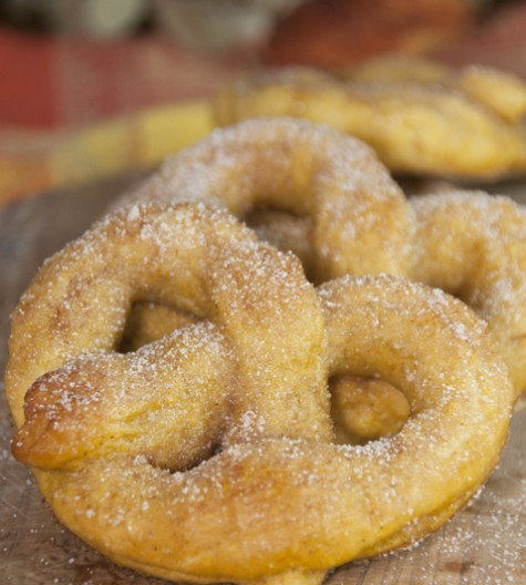 Soft, delicious pumpkin pretzels coated in cinnamon sugar made from scratch and perfect for fall! Pumpkin season isn't complete without these.